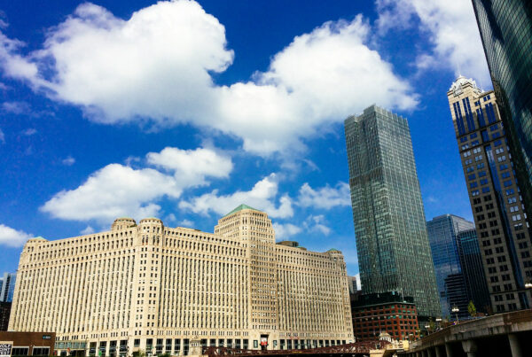 Merchandise Mart in Chicago with a blue sky.