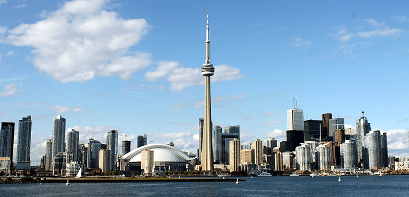 City of Toronto, Canada skyline with a blue sky.